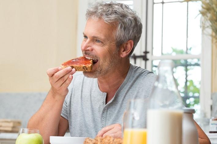 Man Eating A Jam Toast
